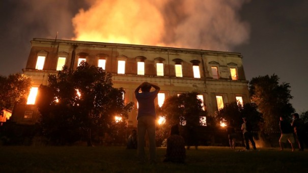 People watch as a fire burns at the National Museum of Brazil in Rio de Janeiro